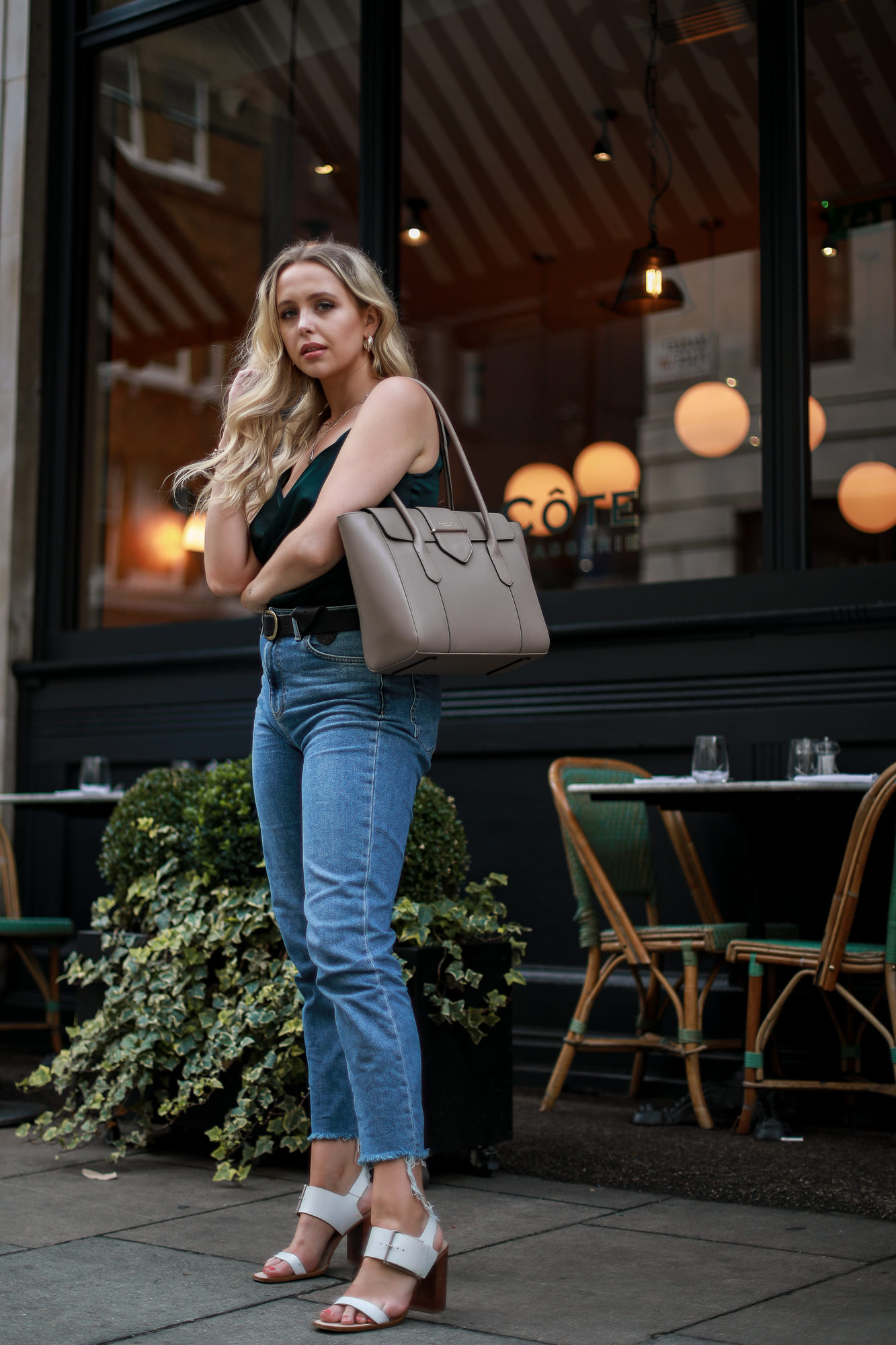 large-shoulder-bag-straight-leg-jeans-evening-top
